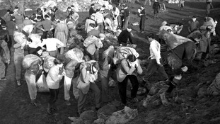 Cambridge undergraduates carry sandbags as they help to repair the Ouse bank at Magdalen near King's Lynn, Norfolk.