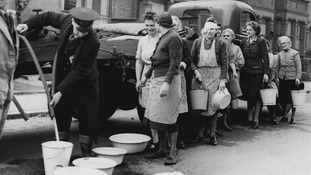East London resident queue to get their supply of water from the Wanstead Council Water Wagon.