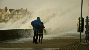 People struggle to make their way along the Esplanade, Porthcawl, south Wales.