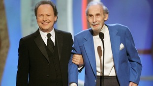 Legendary comedian Sid Caesar accepts an award from Billy Crystal in 2006.