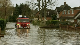 A fire truck attempts to wade through flooding in Wraysbury, Berkshire.