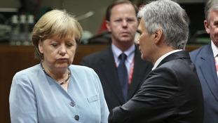 German Chancellor Angela Merkel speaks Chancellor of Austria Werner Faymann