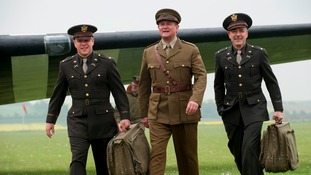 Matt Damon, Hugh Bonneville and George Clooney on set at IWM Duxford