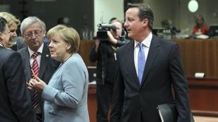 David Cameron arrives in the meeting room of EU leaders in Brussels