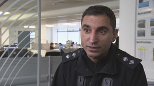 Policeman being interviewed in office