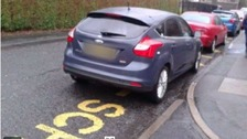 Cars parked on zig zag lines outside schools.