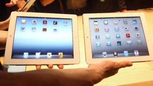 The new Apple iPad (left) is unveiled next to the iPad 2 (right)