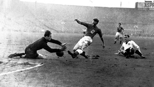 West Germany goalkeeper Fritz Herkenrath saves at the feet of England's Tom Finney