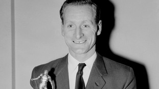Tom Finney holds up the Footballer of the Year trophy in 1957, becoming the first player to win the award twice