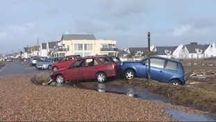 Cars were left strewn across the seafront after the waves.