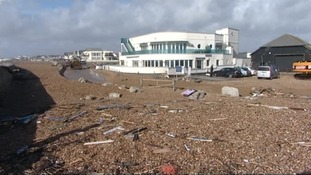 Debris strewn across the seafront after the waves.