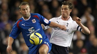 Stevenage's Joel Byrom (left) and Tottenham Hotspur's Scott Parker