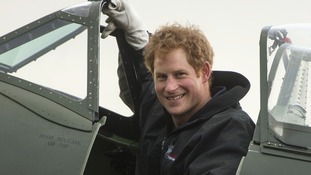 Prince Harry climbed into the cockpit of a Spitfire and started the engine.