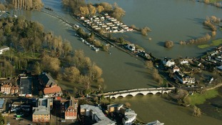 Flood water surrounds homes in Chertsey, Surrey.
