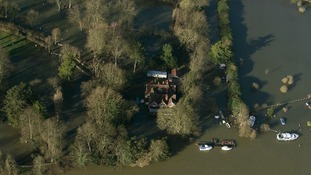 Flood water surrounds homes in Chertsey, Surrey