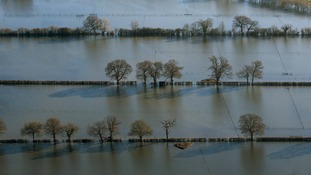 Flood water covers fields in Chertsey, Surrey.