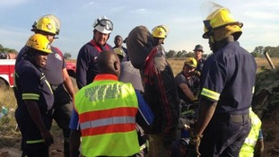 "Emergency services at the scene of an abandoned shaft where 30 ""illegal miners"" were trapped."