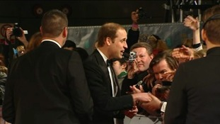 Prince William greets the public at the red carpet of the Bafta awards.