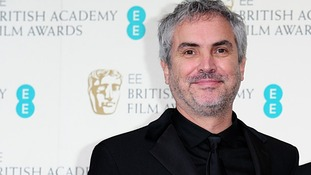 Director of 'Gravity', Alfonso Cuarón, wins the award for best director at the Baftas.