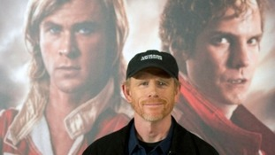 Director Ron Howard with the Rush promotional poster