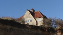 House in danger of falling off cliff sells