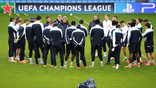 Manchester city team standing in a circle.