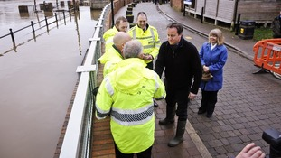 Prime Minister David Cameron chats with employees of the Environment Agency in Upton-upon-Severn.