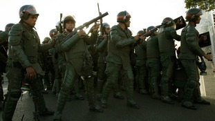 Riot police pictured during the protest in Caracas.