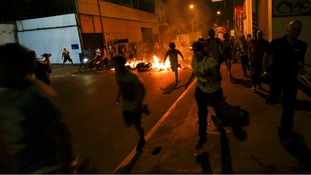 Riot police and protesters clashed again last night.