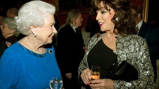 The Queen and Joan Collins at the Buckingham Palace reception.