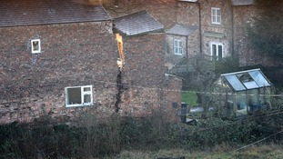 A view of a large crack on a house in Magadalen's Close, Ripon after a huge 25ft wide sinkhole opened up in the street.