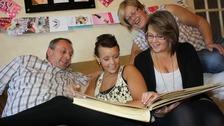Family looking at photos