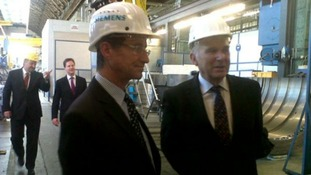 The Deputy Prime Minister Nick Clegg and the Business Secretary Vince Cable tour a Siemens factory in Berlin