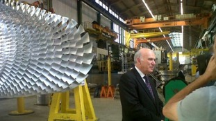 Vince Cable is seen during the tour of Siemens factory.