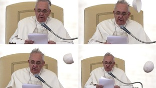 Pope Francis battles blustery winds in Vatican prayer service