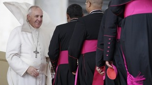 The Pope greeted cardinals in the windy weather.