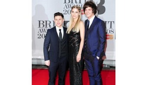 London Grammar arrive ahead of tonight's Brit Awards show.