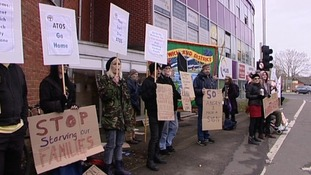 The demonstrators outside St Mary's House in Norwich today.