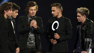 Harry Styles takes the mic after eventually making his way on stage.