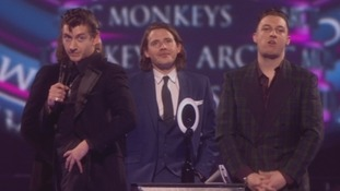 Arctic Monkeys take to the stage.