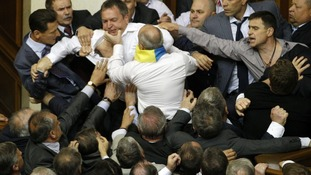 Opposition deputies brought proceedings to a halt inside the Ukrainian parliament