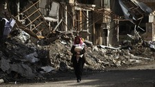 A man walks along a damaged street in Deir al-Zor, eastern Syria, earlier this week.