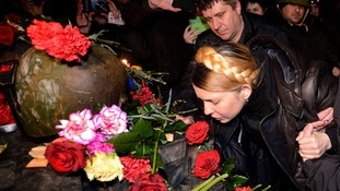 Ukraine opposition leader Yulia Tymoshenko pays tribute at the spot where a protester died.