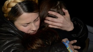 Ukrainian opposition leader Yulia Tymoshenko hugs her daughter Yevgenia after arriving in Kiev.