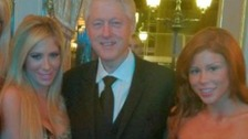Bill Clinton with Tasha Reign (left) and Brooklyn Lee