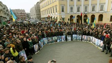 People gather to commemorate the victims of the recent clashes in Kiev.