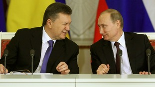 Ukraine's Viktor Yanukovich gives a wink to Vladimir Putin in December last year.