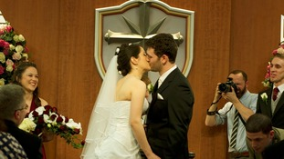 The couple share their first kiss as man and wife.