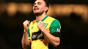 Norwich City's goalscorer Robert Snodgrass celebrates at the end of the Barclays Premier League match against Tottenham.