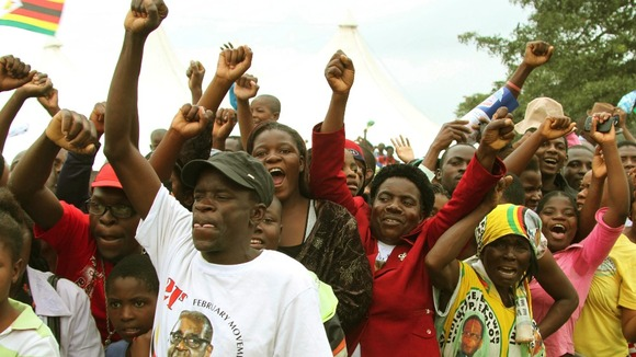 The crowd cheers for Zimbabwean President Robert Mugabe at his birthday celebrations>